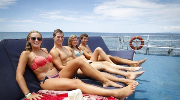 Tanning on sundeck during cruise