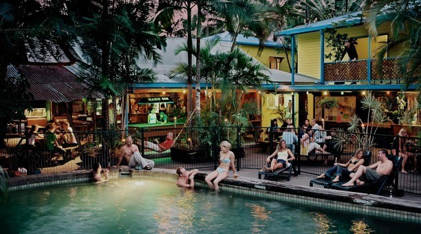 Chill out around the pool at Calypso Backpackers Hostel Cairns