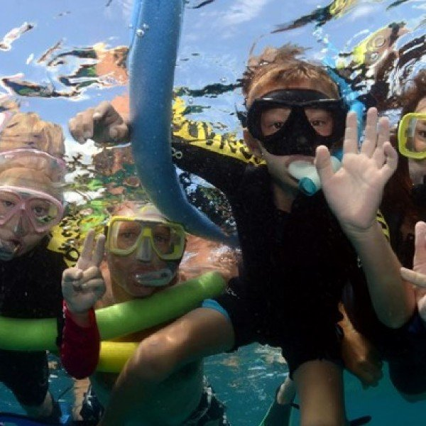 Family snorkeling Great Barrier Reef Cairns, Australia