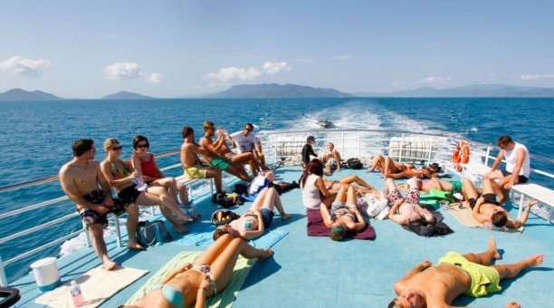 Relax on our sun-deck Compass Cruises, Great Barrier Reef Australia