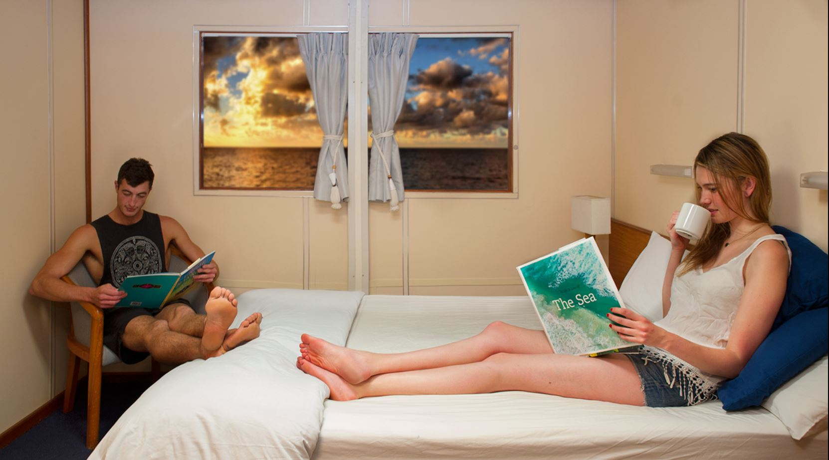 Couple relaxing in Double Stateroom