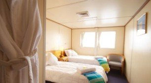 Reef Encounter's reef accommodation twin top deck club stateroom
