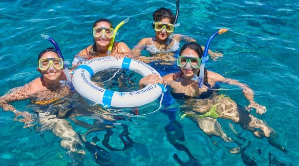 Snorkelling with friends is fun on Compass Cruises
